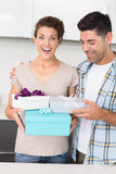 Shocked woman holding many gifts from her partner Royalty Free Stock Image