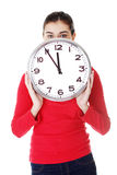 Shocked woman holding office clock. Isolated on white bacvkground Royalty Free Stock Photography
