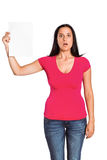 Shocked woman holding piece of paper Stock Photography