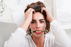 Shocked woman look at camera with pencil in mouth Stock Image