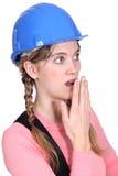 Shocked woman looking away. Shocked woman in blue hard hat looking away Stock Photos