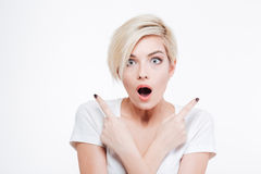 Shocked woman looking at camera Stock Photo