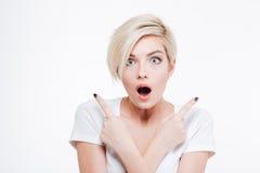 Shocked woman looking at camera Stock Photo