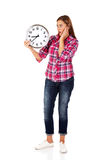 Shocked woman looking for clock Stock Photo