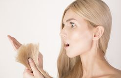 Shocked woman looking on her new haircut. Royalty Free Stock Photos
