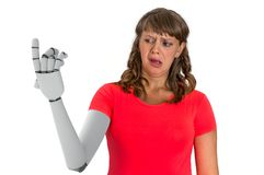 Shocked woman is looking at her prosthetic robotic hand stock image