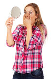 Shocked woman looking into mirror Stock Photography