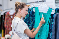 Shocked woman looking at price tag Royalty Free Stock Image