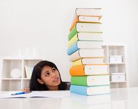 Shocked Woman Looking At Stack Of Books Royalty Free Stock Photography