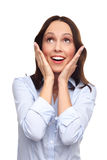 Shocked woman looking up. Young woman over white background Royalty Free Stock Images