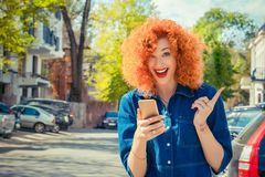 Shocked woman looking at you phone in hand she received some goo royalty free stock images