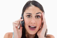 Shocked woman making a phone call Stock Photography