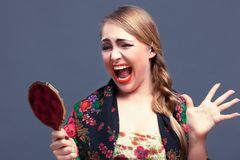 Shocked woman in a with mirror Royalty Free Stock Photography