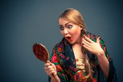 Shocked woman in a with mirror Stock Photo