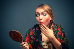 Shocked woman in a with mirror Royalty Free Stock Image