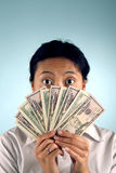 Shocked Woman with Money. Covering her face Stock Photos
