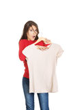 Shocked woman with a new shirt. Stock Photos