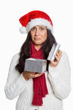 Shocked woman opening christmas present Royalty Free Stock Images