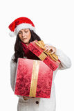 Shocked woman opening christmas present Stock Images