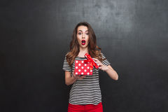 Shocked woman opening a gift box Royalty Free Stock Image