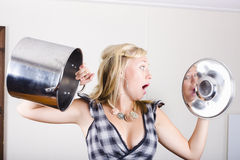 Shocked woman out of cooking ingredients Stock Photos