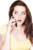 Shocked woman on the phone Stock Image