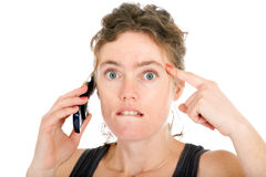 Shocked woman on phone Stock Image