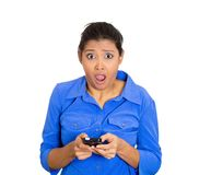 Shocked woman with phone Royalty Free Stock Image