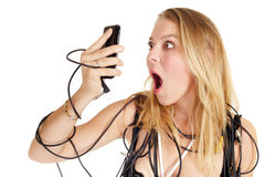 Shocked woman phoning Royalty Free Stock Photography
