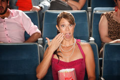 Shocked Woman with Popcorn Stock Images
