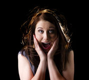Shocked woman. Portrait isolated on black background with backlight Royalty Free Stock Image