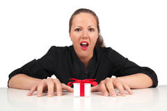Shocked woman with present box Stock Images