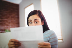 Shocked woman reading letter Royalty Free Stock Photo