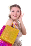 Shocked woman with shopping bags Stock Images