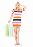 Shocked woman with shopping bags Royalty Free Stock Images