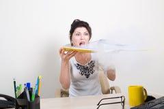 Shocked woman with smoking folder Stock Photos