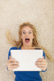 Shocked woman with tablet Stock Photography