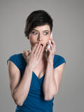 Shocked woman talking on the mobile phone Royalty Free Stock Images