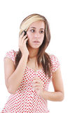 Shocked woman talking on phone Stock Photography