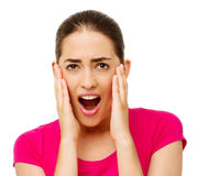 Shocked Woman Touching Cheeks Over White Background Royalty Free Stock Images