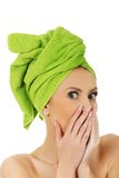 Shocked woman with turban towel. Royalty Free Stock Photo