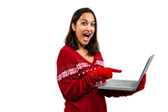 Shocked woman using laptop while wearing warm clothing Royalty Free Stock Photo