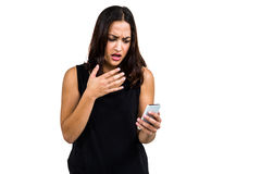 Shocked woman using phone Stock Image