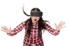 Shocked woman in VR playing and traveling in cyberspace. Stock Photo