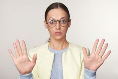 Shocked woman wearing spectacles royalty free stock image