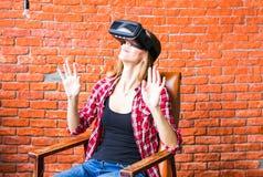 Shocked woman wearing virtual reality goggles Stock Image