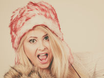 Shocked woman in winter furry hat Royalty Free Stock Images