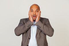 Free Shocked Young African American Guy Businessman Expressing Surprise And Amazement, Touching His Face And Folding His Lips, Stands Royalty Free Stock Photography - 199265417