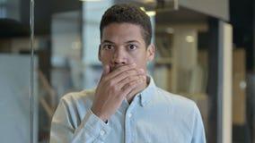 Shocked Young African Man Wondering in Awe