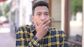 Shocked young african man wondering for results stock footage